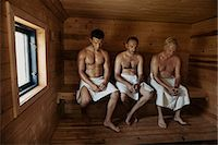 Three men sitting in sauna with heads bowed Stock Photo - Premium Royalty-Freenull, Code: 649-07238960