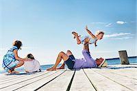 family  fun  outside - Family playing on jetty, Utvalnas, Gavle, Sweden Stock Photo - Premium Royalty-Freenull, Code: 649-07238978