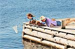 Family fishing on pier, Utvalnas, Gavle, Sweden