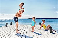 Parents and two young girls on pier, Utvalnas, Gavle, Sweden Stock Photo - Premium Royalty-Freenull, Code: 649-07238986