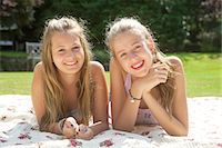 Portrait of two teenage girls lying on picnic blanket Stock Photo - Premium Royalty-Freenull, Code: 649-07239179