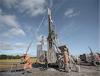 Workers operating drilling rig to explore for coal in field Stock Photo - Premium Royalty-Freenull, Code: 649-07239185