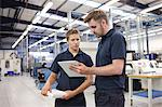 Workers checking order in engineering factory Stock Photo - Premium Royalty-Free, Artist: Cultura RM, Code: 649-07239371