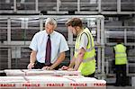 Warehouse worker and manager checking order in engineering warehouse Stock Photo - Premium Royalty-Free, Artist: Blend Images, Code: 649-07239383