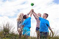 Four friends holding pinwheel, Wales, UK Stock Photo - Premium Royalty-Freenull, Code: 649-07239480