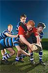 Young men playing rugby Stock Photo - Premium Royalty-Free, Artist: Robert Harding Images, Code: 649-07239533