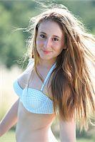 Portrait of teenage girl wearing bikini top Stock Photo - Premium Royalty-Freenull, Code: 649-07239582