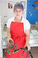 Woman holding fresh lobsters Stock Photo - Premium Royalty-Freenull, Code: 649-07239618