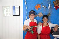 Women holding fresh lobsters Stock Photo - Premium Royalty-Freenull, Code: 649-07239619