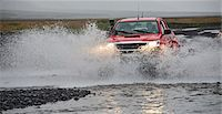 Customised SUV driving through river, Thorsmork, Iceland Stock Photo - Premium Royalty-Freenull, Code: 649-07239682