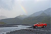 Customised SUV waiting to cross the glacial river Krossa, Thorsmork, Iceland Stock Photo - Premium Royalty-Freenull, Code: 649-07239683