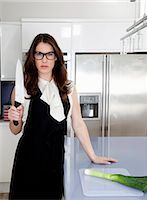 dominant woman - Young woman holding carving knife in kitchen Stock Photo - Premium Royalty-Freenull, Code: 649-07239823