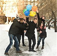 Group of young friends with party hats and balloons Stock Photo - Premium Royalty-Freenull, Code: 649-07239881