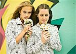 Two young women holding bunches of daisies Stock Photo - Premium Royalty-Free, Artist: Cultura RM, Code: 649-07239893