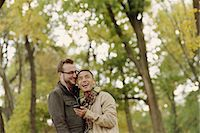 Gay couple hugging in park Stock Photo - Premium Royalty-Freenull, Code: 614-07239944