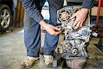 Mechanic working on car part Stock Photo - Premium Royalty-Free, Artist: Ikon Images, Code: 649-07239911