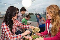 Young adult friends enjoying food at barbeque Stock Photo - Premium Royalty-Freenull, Code: 614-07240195