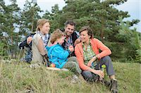 Family taking a rest from their hiking tour Stock Photo - Premium Rights-Managednull, Code: 853-07241834
