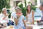Girl eating watermelon at picnic