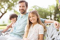 preteen family - Father and children smiling on bench Stock Photo - Premium Royalty-Freenull, Code: 6113-07242013
