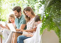 preteen family - Family reading and using technology on patio Stock Photo - Premium Royalty-Freenull, Code: 6113-07242020