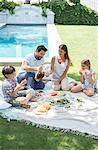 Family enjoying picnic in backyard Stock Photo - Premium Royalty-Freenull, Code: 6113-07242059