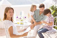 preteen family - Family relaxing on patio Stock Photo - Premium Royalty-Freenull, Code: 6113-07242096