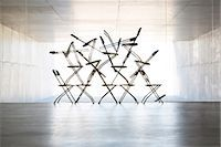 Silhouette of office chair installation art Stock Photo - Premium Royalty-Freenull, Code: 6113-07242148