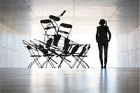 Businesswoman examining office chair installation art Stock Photo - Premium Royalty-Freenull, Code: 6113-07242190