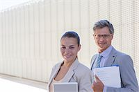 partnership - Business people smiling outdoors Stock Photo - Premium Royalty-Freenull, Code: 6113-07242211