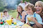 Family eating together outdoors Stock Photo - Premium Royalty-Free, Artist: Blend Images, Code: 6113-07242307