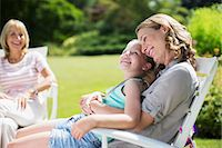 Mother and daughter relaxing in backyard Stock Photo - Premium Royalty-Freenull, Code: 6113-07242310