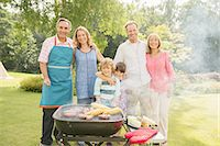 Multi-generation family standing at barbecue in backyard Stock Photo - Premium Royalty-Freenull, Code: 6113-07242313