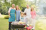 Multi-generation family standing at barbecue in backyard Stock Photo - Premium Royalty-Free, Artist: Cultura RM, Code: 6113-07242313