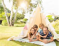 family  fun  outside - Family relaxing in teepee in backyard Stock Photo - Premium Royalty-Freenull, Code: 6113-07242388
