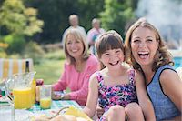 Multi-generation family laughing at table in backyard Stock Photo - Premium Royalty-Freenull, Code: 6113-07242423