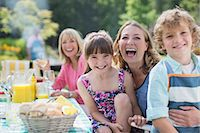 family  fun  outside - Family at table in backyard Stock Photo - Premium Royalty-Freenull, Code: 6113-07242427