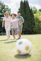 female playing soccer - Grandparents and grandson playing soccer Stock Photo - Premium Royalty-Freenull, Code: 6113-07242439