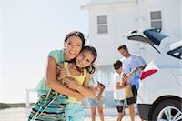 Mother and daughter hugging outside beach house Stock Photo - Premium Royalty-Freenull, Code: 6113-07242491