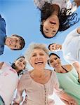 Multi-generation family smiling in huddle