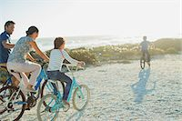 pre-teen beach - Family riding bicycles on sunny beach Stock Photo - Premium Royalty-Freenull, Code: 6113-07242565