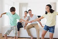 preteen dancing - Parents watching daughter and son dancing in living room Stock Photo - Premium Royalty-Freenull, Code: 6113-07242589