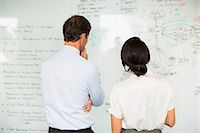 strategy - Business people reading whiteboard in office Stock Photo - Premium Royalty-Freenull, Code: 6113-07242709