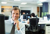 Businessman wearing headset in office Stock Photo - Premium Royalty-Freenull, Code: 6113-07242742