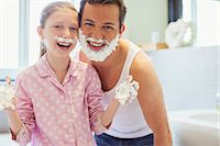 Father and daughter playing with shaving cream Stock Photo - Premium Royalty-Freenull, Code: 6113-07242931
