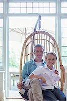 father with two sons not girls - Father and son sitting in wicker chair Stock Photo - Premium Royalty-Freenull, Code: 6113-07242967
