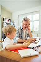 father with two sons not girls - Father and son working in home office Stock Photo - Premium Royalty-Freenull, Code: 6113-07242977
