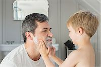 father with two sons not girls - Boy rubbing shaving cream on father's face Stock Photo - Premium Royalty-Freenull, Code: 6113-07243019