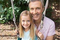 swing (sports) - Father pushing daughter on swing Stock Photo - Premium Royalty-Freenull, Code: 6113-07243023