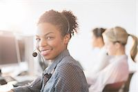 Businesswoman wearing headset in office Stock Photo - Premium Royalty-Freenull, Code: 6113-07243036